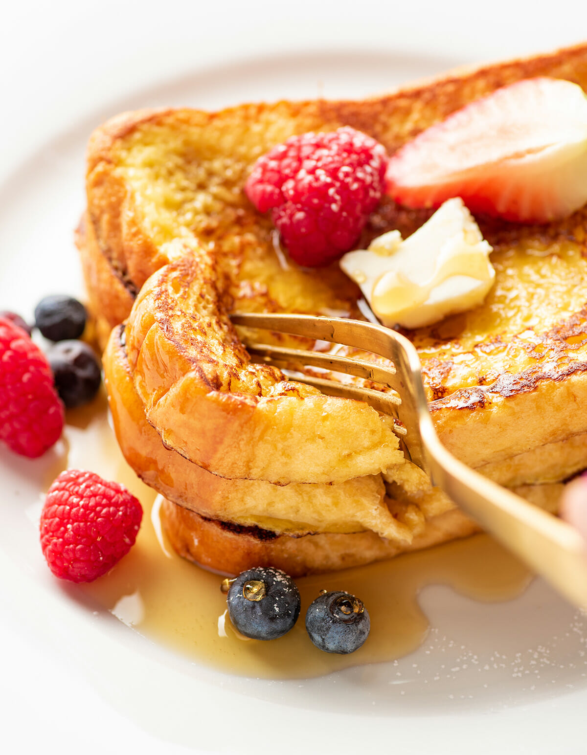 Homemade easy French toast topped with maple syrup and berries