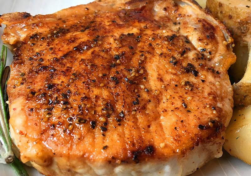 Bone-in Instant Pot pork chops on a plate.