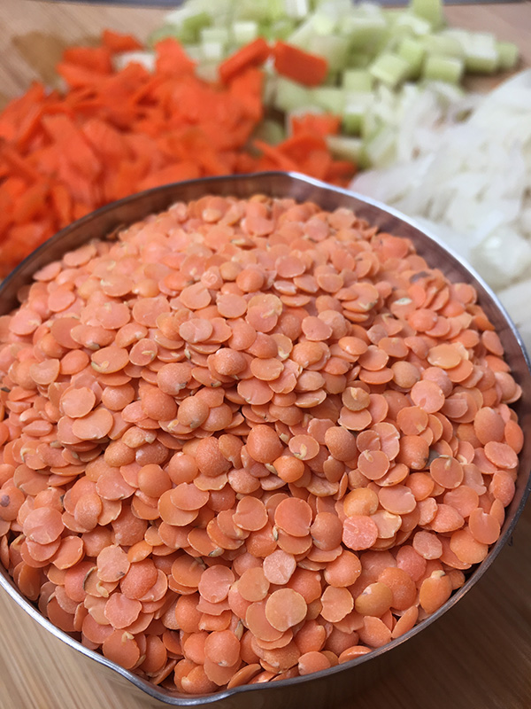 Red lentils and diced carrots, celery and onion for Instant Pot red lentil soup.