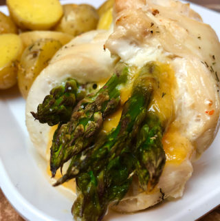 Boneless, skinless chicken breast stuffed with cheddar cheese and asparagus