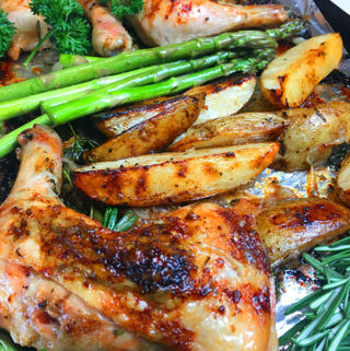sheet pan balsamic and rosemary chicken quarters with potato wedges