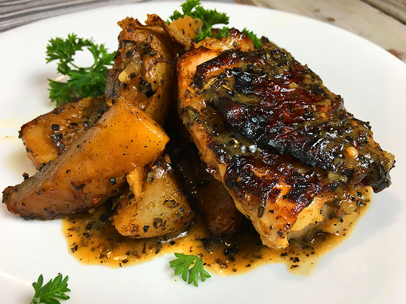 dish of Instant Pot chicken thighs and potatoes with Greek seasonings