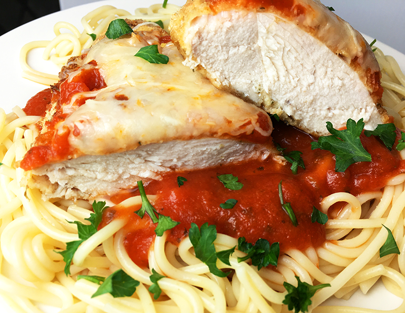 Baked chicken parmesan with spaghetti