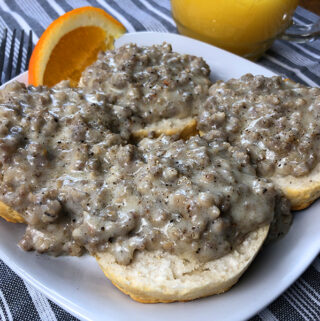 A plate of biscuits and gravy with homemade sausage gravy from an Instant Pot electric pressure cooker.