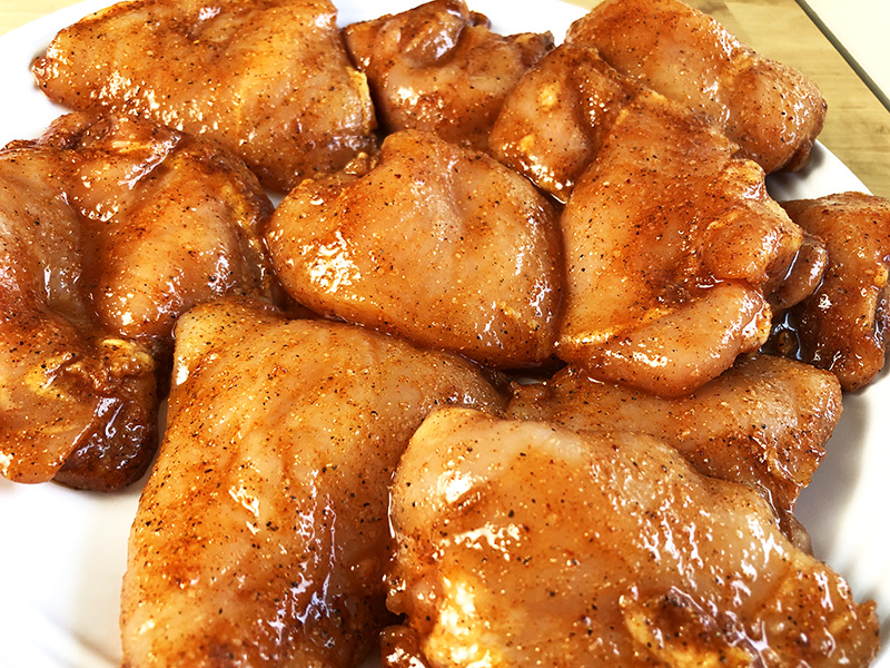 chicken thighs and chicken breasts seasoned to make pulled chicken in an Instant Pot pressure cooker