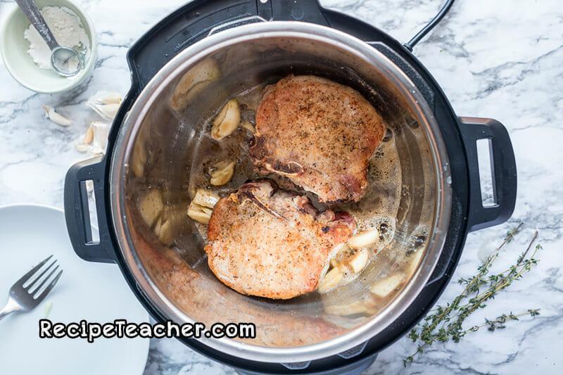 recipe for Instant Pot Creamy Garlic Pork Chops