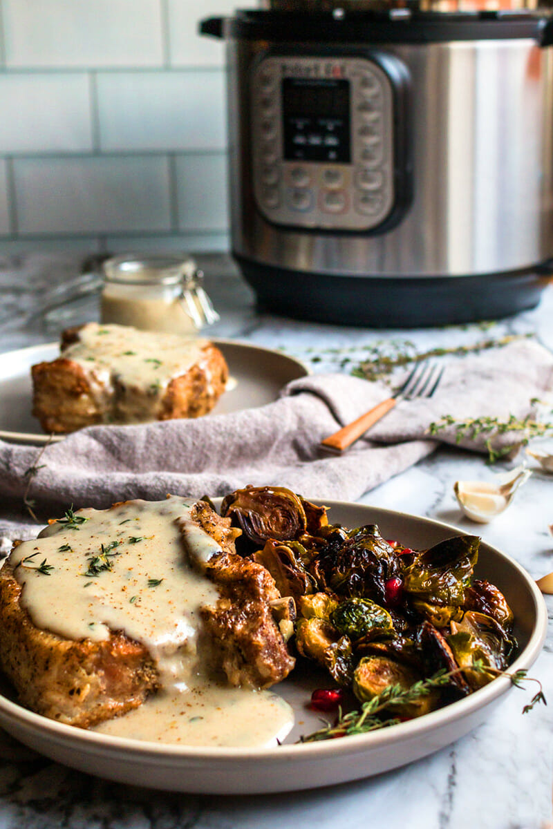 Smothered creamy garlic pork chops recipe made in an Instant Pot