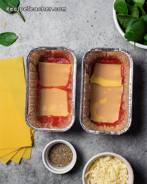 Assembling lasagna for Instant Pot lasagna recipe