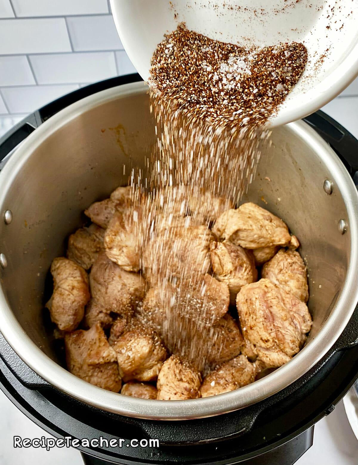 Seasoning meat for Instant Pot carnitas recipe