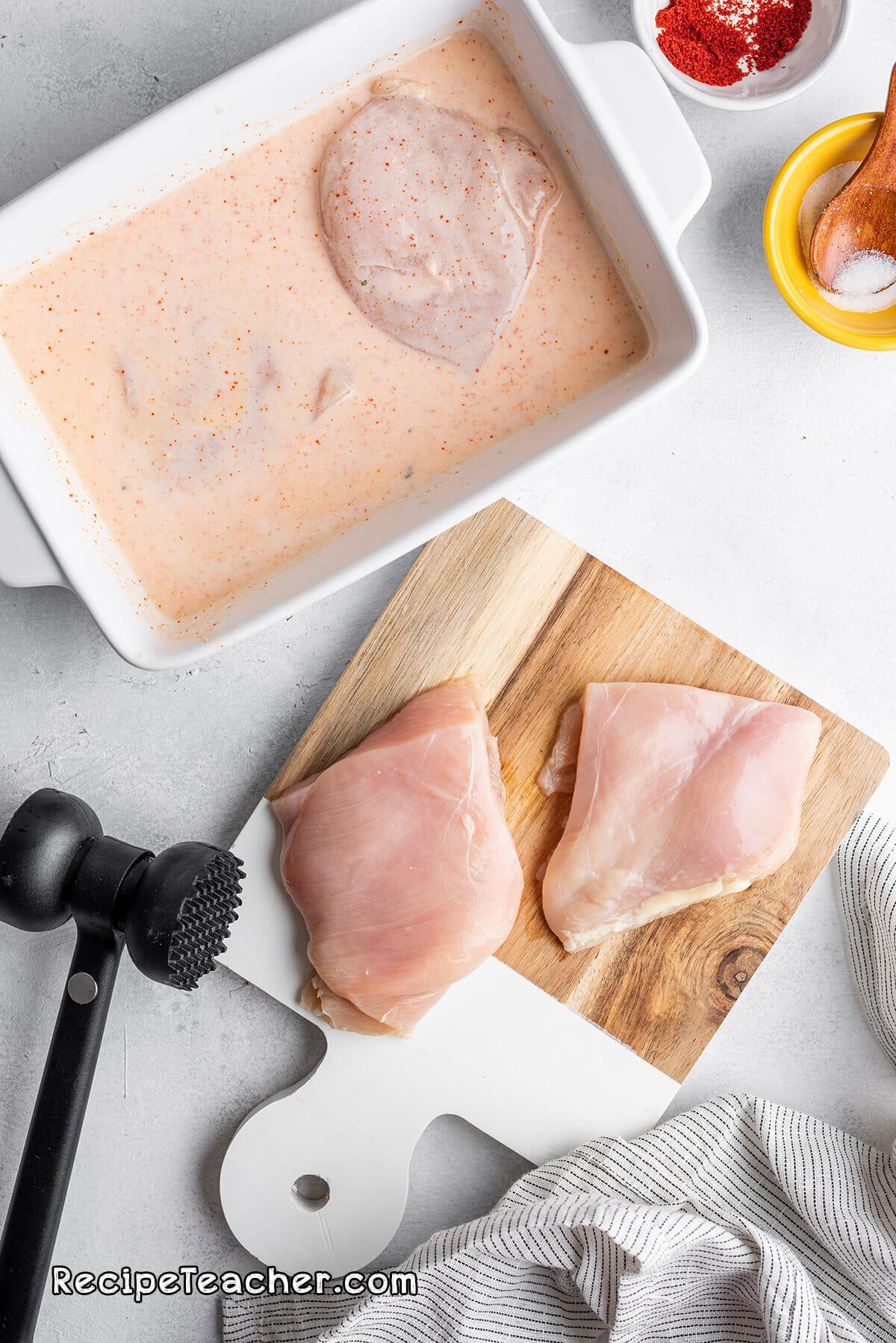 Preparing the chicken for our air fryer buttermilk chicken sandwich recipe
