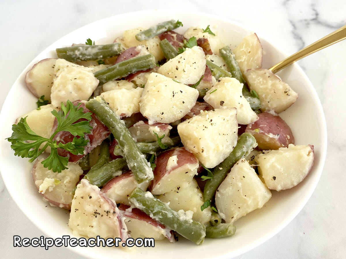 Instant Pot Red Potatoes with Green beans in a creamy Parmesan garlic sauce.