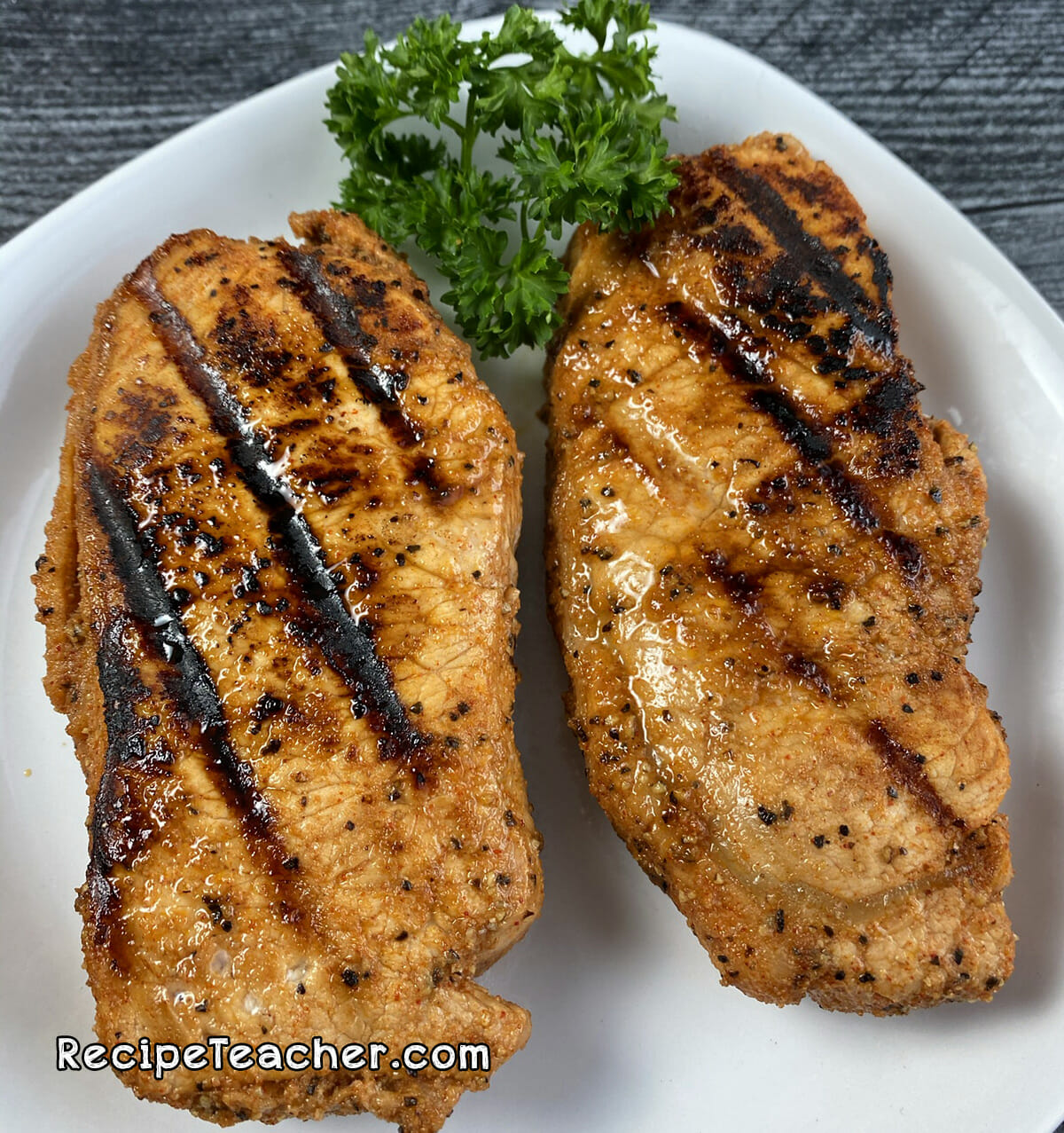 Boneless pork chops cooked on a George Foreman Grill.