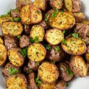 Simply irresistible air fryer roasted potatoes seasoned with garlic and herbs.