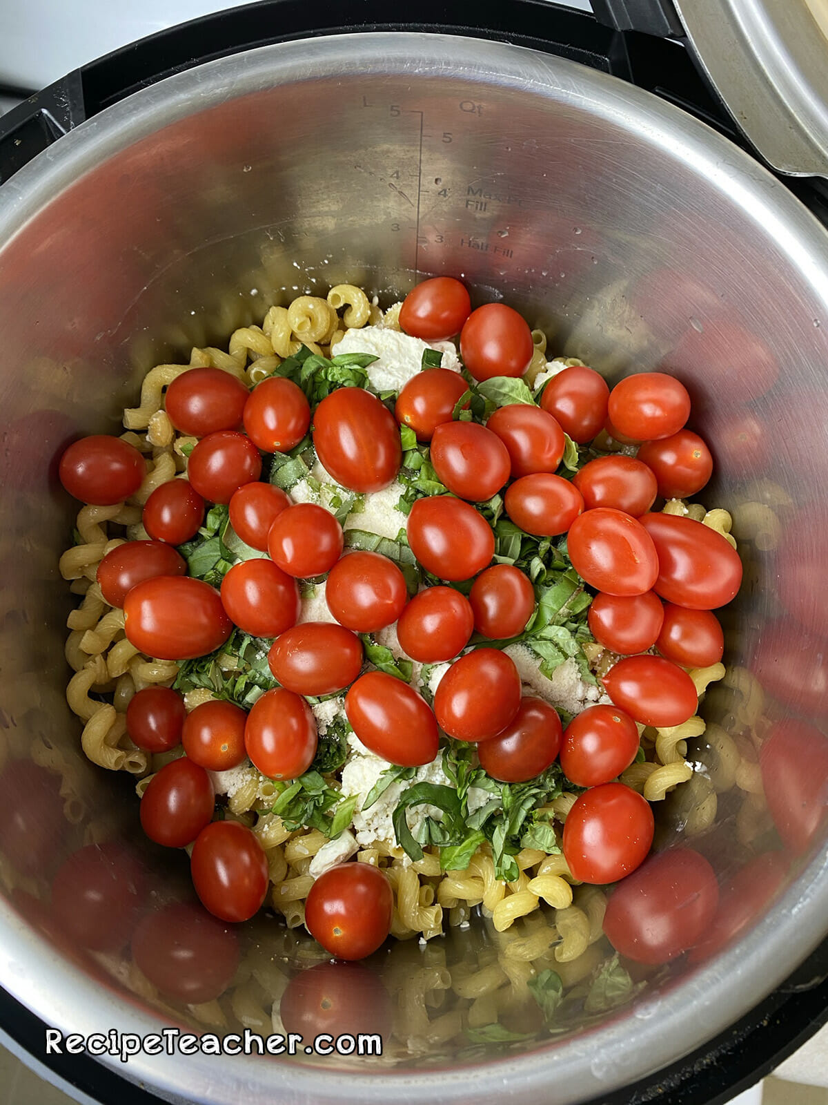 Recipe for Instant Pot Feta Cheese pasta with basil and cherry tomatoes.