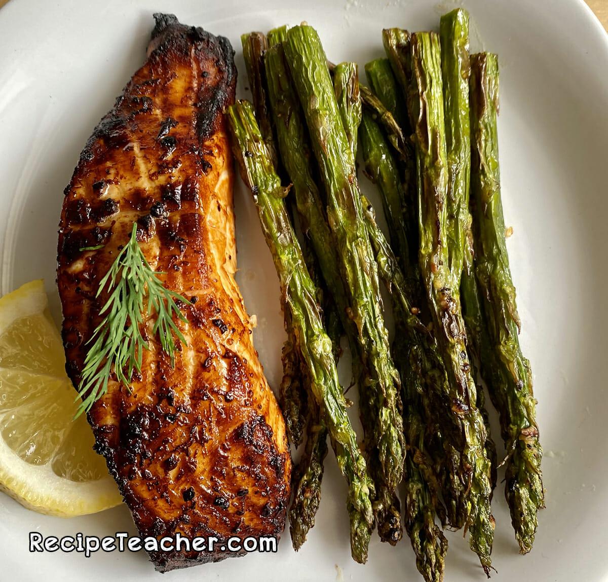 Air fryer citrus garlic salmon served with asparagus.