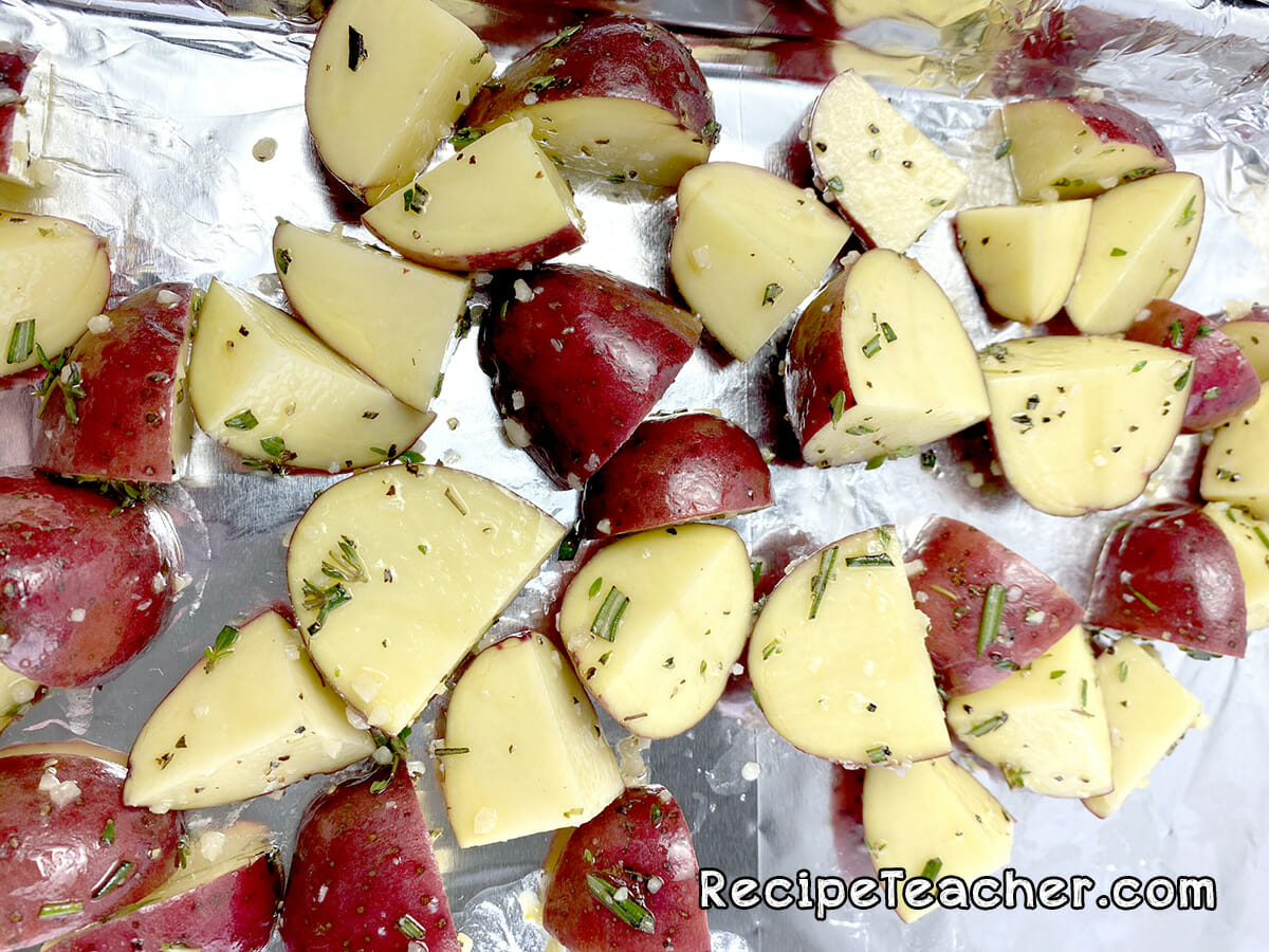 Sheet pan pork chops and baby red potatoes.