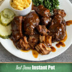 Instant Pot country style ribs served with sautéed spinach and homemade mac and cheese.